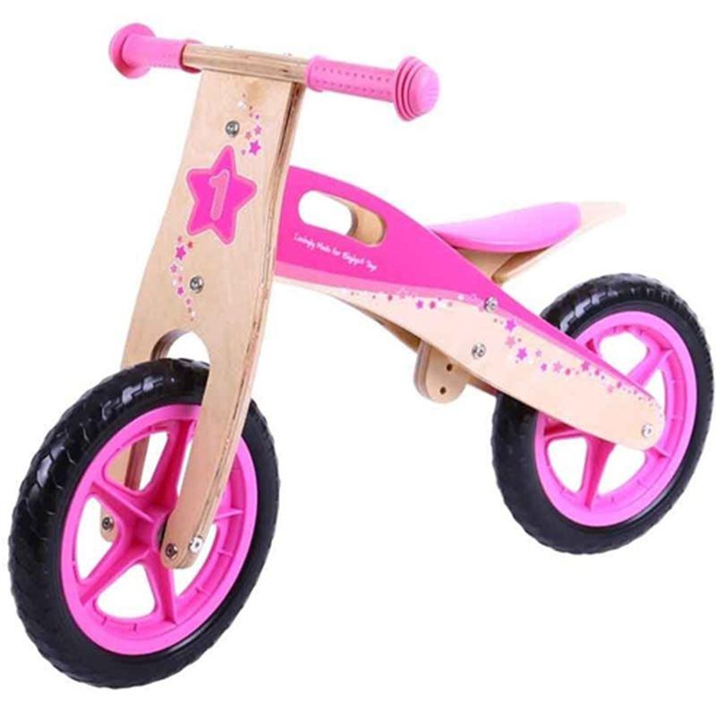 Immagine di bicicletta senza pedali rosa
